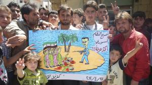 مظاهرة احتجاجية ضد نظام الأسد. في منطقة كفرنبل السورية. Foto: Reuters