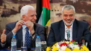 إسماعيل هنية ممثل حماس وعزام الأحمد ممثل فتح 23 / 04 / 2014. Foto: Reuters