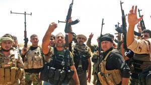 مقاتلون من قوات البشمركة الكردية والمتطوعين الشيعة في العراق. Foto: picture-alliance/dpa
