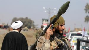 إمام شيعي ومقاتل شيعي في العراق. Foto: Reuters