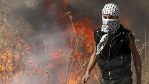 متظاهر فلسطيني في غزة. Foto: Reuters/M. Salem