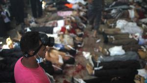 في أعقاب اقتحام رابعة والنهضة في القاهرة  14 أغسطس/ آب 2013. (photo: Mosaab el-Shamy/AFP/Getty Images)
