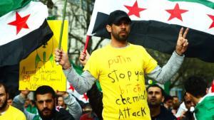 احتجاج معارضين سوريين على استخدام نظام الأسد للأسلحة الكيمياوية. Foto: dpa/picture-alliance