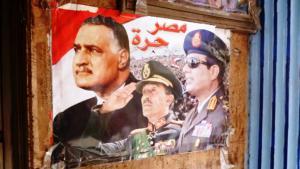 السيسي بجانب صورة السادات وجمال عبد الناصر. الصورة أريان فاريبورز القاهرة