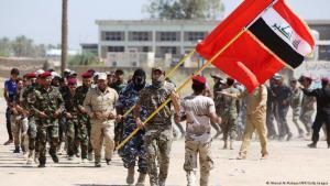 ميليشيات شيعية في العراق مدهومة من إيران شاركت في محاربة داعش. الصورة.  Ahmad al Rubyye afp Getty Images