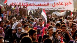 من مظاهرات الربيع العربي - لافتة مكتوب عليها: الشعب أسقط النظام