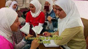مشعه من احتفال لحركة القبيسات في سوريا. الصورة: يوتيوب