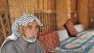 عبد جلوب الأسدي من سكان هور الجبايش العراقي. الصورة: ملهم الملائكة