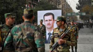 ;  قوات النظام السوري تحتفل في 21 ديسمبر 2017 باسترداد مدينة حلب من المتمردين والجيش السوري الحر  Foto: Getty Images/AFP