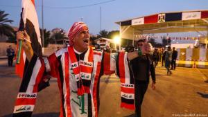 (photo: Getty Images/AFP/A. Al-Rubaye) عرقيون يحتفلون بفتح المنطقة الخضراء في 18 دسيسمبر 2018