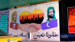 بغداد، العراق، ملصق يدعو لتبذ العنف ونشر المحبة في بلاد الرافدين.