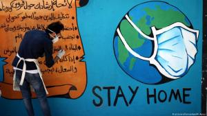 جدارية حول فيروس كورونا في قطاع غزة.  Foto: picture-alliance/dpa/M.Ajjour