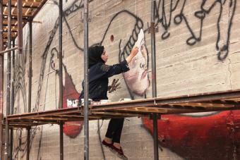 """جدارية """"هنا أرض كنعان"""" في الأراضي الفلسطينية، الصورة مهند حامد"""