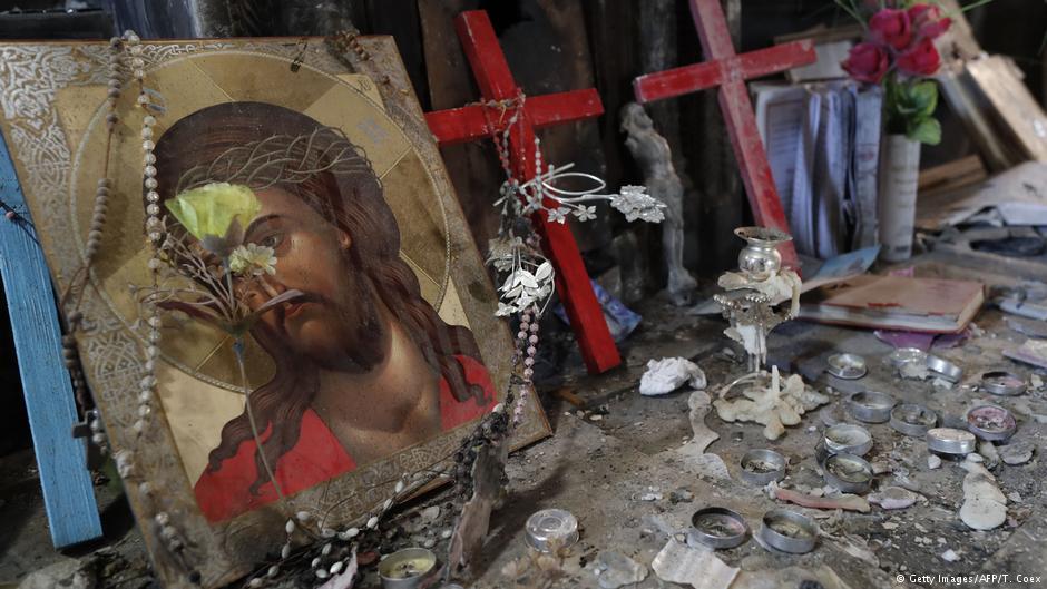 المسيحيون في العراق: مسيحي عراقي: أخشى العودة لداري حتى بعد تحريرها -  Qantara.de